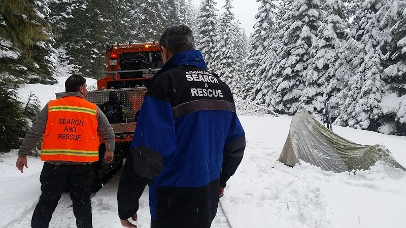 Members of Search and Rescue Team in the Snow
